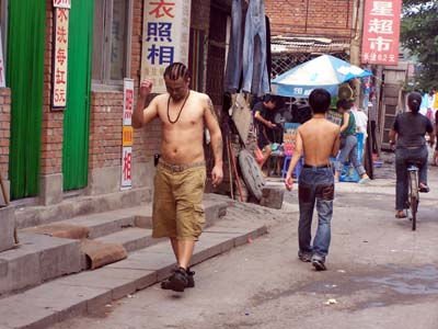 Peking-Hutong, Tatoo-Mann
